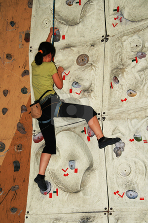 Female rock climber stock photo, Female rock climber inside an indoor rock climbing wall by Jonas Marcos San Luis