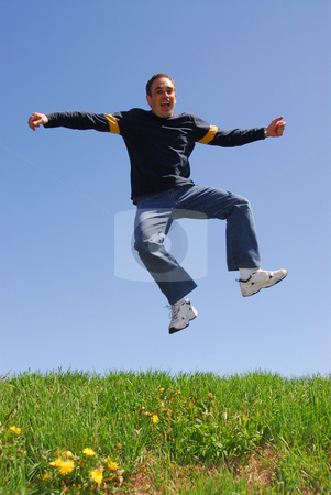 Man jump happy stock photo, Man jumping in joy by Elena Elisseeva