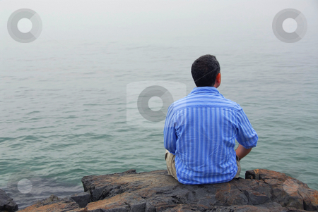 Man looking at fog stock photo, Man looking at the foggy ocean. Uncertain future concept. by Elena Elisseeva