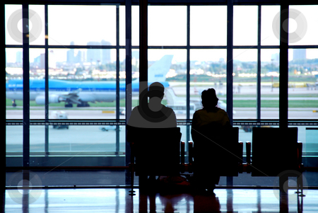 Couple airport stock photo, Couple waiting at the international airport terminal by Elena Elisseeva
