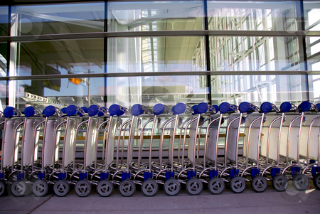 Luggage carts airport stock photo, Luggage carts at modern international airport by Elena Elisseeva