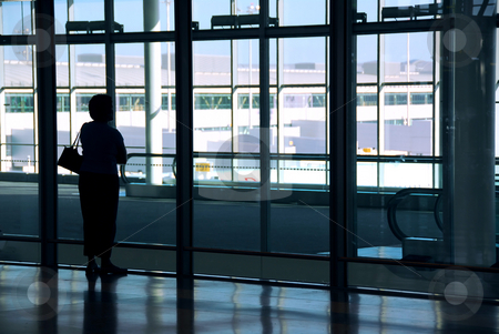 Woman airport stock photo, Woman waiting at the international airport terminal by Elena Elisseeva