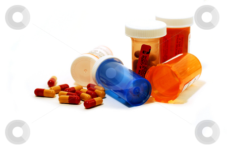 Pills containers white stock photo, Pills and plastic pill containers on white background by Elena Elisseeva