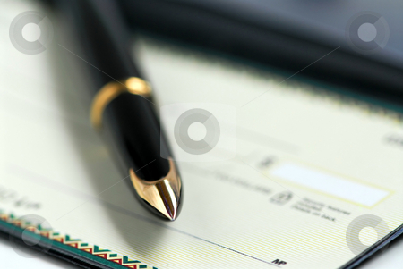 Checkbook pen stock photo, Gold fountain pen and cheque by Elena Elisseeva
