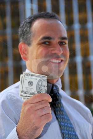 Businessman hold money stock photo, Businessman holding money by Elena Elisseeva