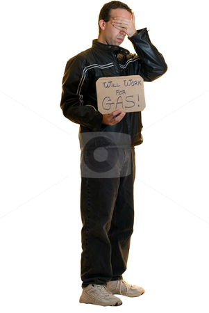 Embarrassed Man stock photo, A young man begging for gas looks embarrassed having to do so by Richard Nelson