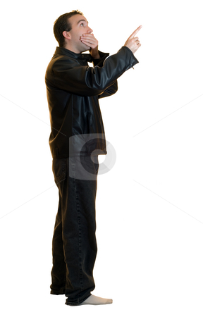 Pointing Male stock photo, A man wearing a black leather jacket pointing at something, looking stunned by Richard Nelson