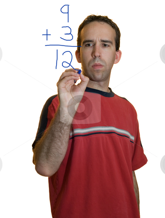 Man Doing Math stock photo, A young man doing simple math with a marker by Richard Nelson