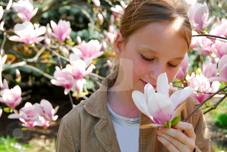 Girl with magnolia stock photo, Girl with blooming magnolia by Elena Elisseeva