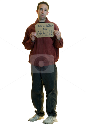 Jobless Man stock photo, A jobless man holding a sign saying he will work for gas, isolated on a white background by Richard Nelson