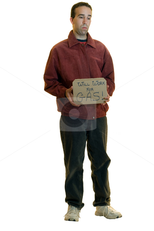 Man Holding Sign stock photo, A young man holding a sign that says he will work for gas, isolated on a white background by Richard Nelson
