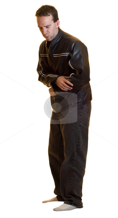 Stomach Ache stock photo, A full body view of a male wearing a black leather jacket and jeans experiencing a stomach ache, isolated on a white background by Richard Nelson