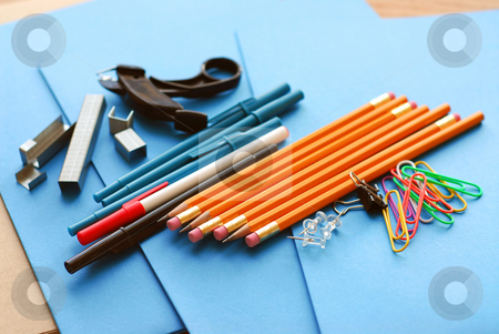 School office supplies stock photo, School or office supplies on blue paper folders by Elena Elisseeva