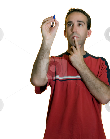 Concentration stock photo, A young man concentrating on something to write by Richard Nelson