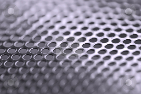 Abstract metal background stock photo, Abstract background of perforated metal with very shallow dof by Elena Elisseeva