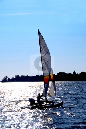 Sailing boat stock photo, Sailing catamaran backlit by Elena Elisseeva