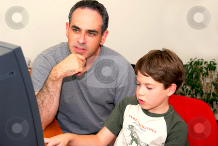 Father son computer stock photo, Father teaching his son to work on a computer by Elena Elisseeva