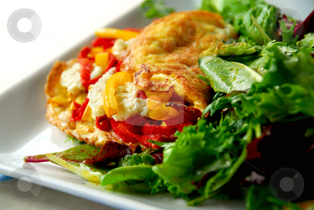 Omelette stock photo, Freshly made omelette served with green salad by Elena Elisseeva