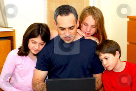 Family computer stock photo, Father and children looking into a portable computer at home by Elena Elisseeva