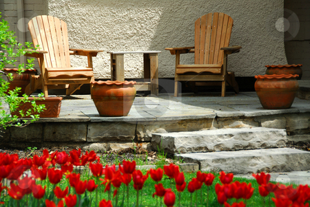 House patio stock photo, House patio with wooden chairs by Elena Elisseeva