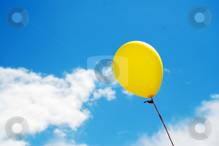 Balloon in a Summer Sky stock photo, A photograph of a brightly coloured yellow balloon, under a perfect blue sky with white clouds by Philippa Willitts