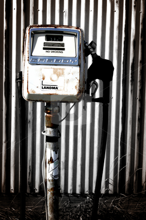 Gas Pump stock photo, Small gas pump in a rustic setting. by Nathan Smith