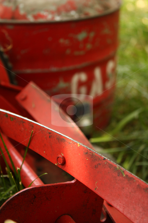 You Choose stock photo, An environmentally friendly red push mower beside an old-fashioned red can of gasoline, both sitting in a lawn that needs cutting or mowing. by Jessica Tooley
