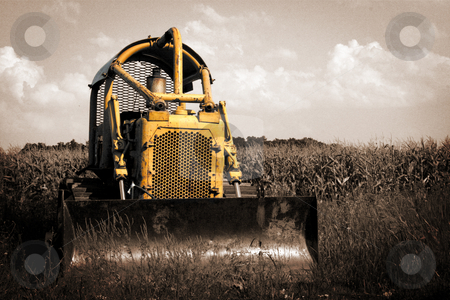 Yellow Dozer stock photo, An old bulldozer rusts away on a farm. by Nathan Smith