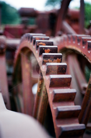 Gears stock photo, Rusty gears of a piece of farm equipment left outside, unused in years. by Rob Wright