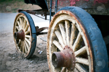 Vintage wheels stock photo, A set of wheels on an old stagecoach. by Rob Wright