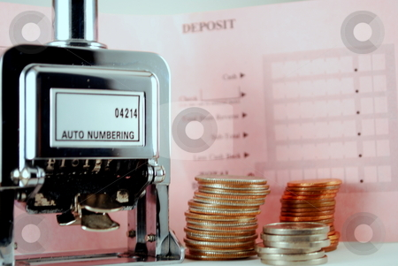Money Counting stock photo, Coins with auto numbering device and deposit slip by Robert Cabrera