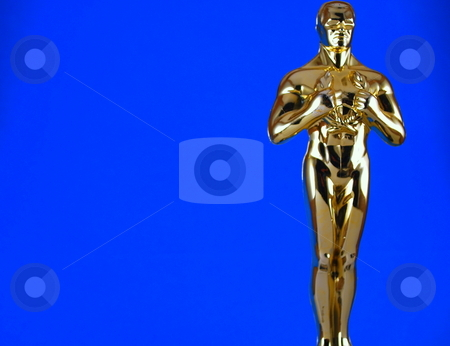Statue on Blue stock photo, Award Statue against blue background by Robert Cabrera
