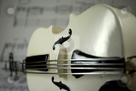 Bass on sheet music angled stock photo, Bass on sheet music background angled by Robert Cabrera