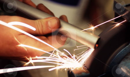 Metal grinder stock photo, Sparks flying from a grinding wheel by Stephen Gibson