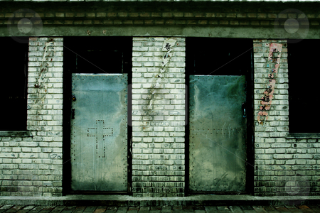 Two Doors stock photo, Two locked, steel doors leading into a dilapidated church classroom in Inner Mongolia by Emyr Pugh