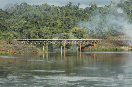 Brokopondo stock photo, Railwaybridge over the water near the powerstation in Brokopondo, Surinam by Claudia Van Dijk