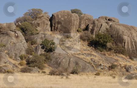 Tanzanian rocks stock photo, Beautiful tanzanian rocks against a blue sky by Claudia Van Dijk