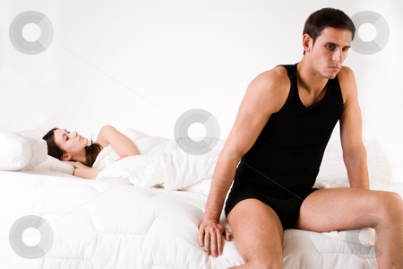 Relation problematic stock photo, Young adult couple in the studio on a bed by Frenk and Danielle Kaufmann