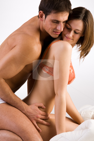 Enjoying couple stock photo, Young adult couple in the studio enjoying by Frenk and Danielle Kaufmann