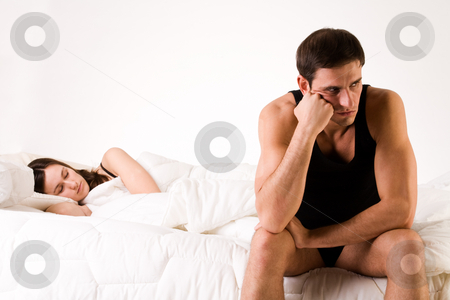 Relation problems stock photo, Young adult couple in the studio on a bed by Frenk and Danielle Kaufmann