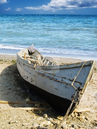 Boat stock photo, Fisherman boat on sand at seacoast watter by Adrian Costea