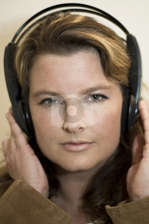 Girl with headphones stock photo, Beautiful girl listening to music with headphones by Claudia Van Dijk
