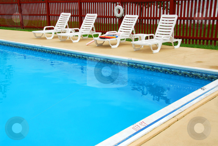 Swimming pool stock photo, Empty swimming pool on a luxury hotel by Elena Elisseeva