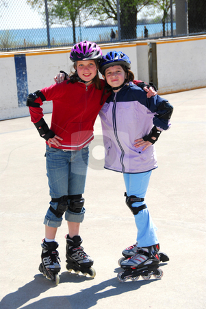 Two girls rollerblading stock photo, Two young girls rollerblading by Elena Elisseeva