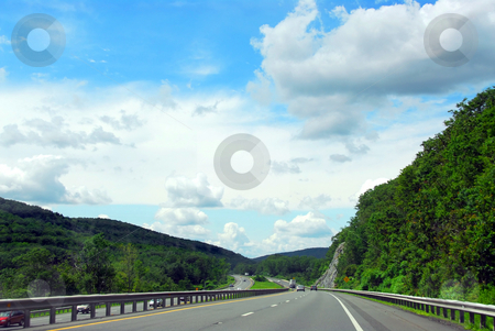 Highway  stock photo, Divided highway among green rolling hills by Elena Elisseeva
