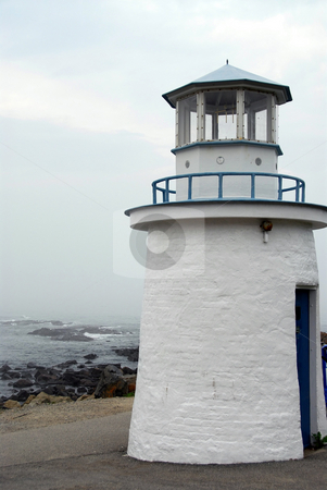 Lighthouse stock photo, Small lighthouse on the Altantic coast in Maine, USA by Elena Elisseeva