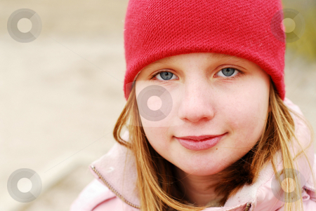 Girl in a red hat stock photo, Portrait of a girl in a red hat by Elena Elisseeva