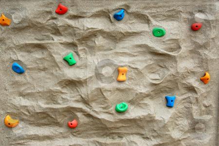 Rock climbing wall stock photo, Rock climbing wall background by Elena Elisseeva