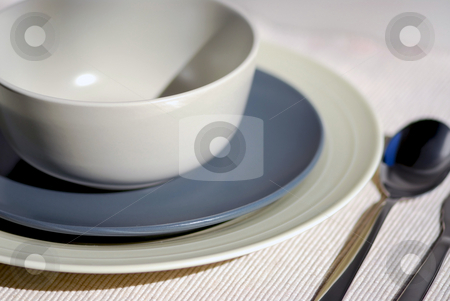 Place setting stock photo, Dinner place setting  - plates bowl and cutlery by Elena Elisseeva