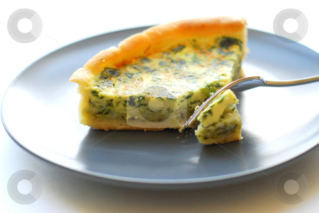Quiche stock photo, Spinach quiche on a plate with fork by Elena Elisseeva